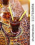 iced coffee with a straw | Shutterstock . vector #1117336856