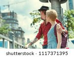 young couple of travelers with... | Shutterstock . vector #1117371395