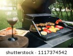 young man grilling some meat... | Shutterstock . vector #1117374542