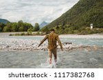 Guy Crosses The River In The...