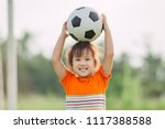 kid with smiling face playing... | Shutterstock . vector #1117388588