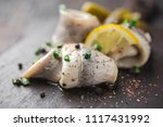 Stock photo classic marinated herring rolls with chives and lemon 1117431992