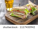 club sandwich served with beer | Shutterstock . vector #1117433942