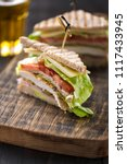 club sandwich served with beer | Shutterstock . vector #1117433945