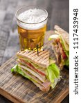 club sandwich served with beer | Shutterstock . vector #1117433948