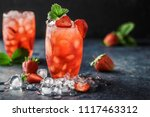 Stock photo fresh strawberry cocktail fresh summer cocktail with strawberry and ice cubes glass of strawberry 1117463312