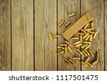 gun with bullets on wooden... | Shutterstock . vector #1117501475