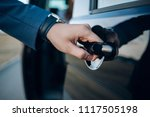 hand on handle. close up of man ... | Shutterstock . vector #1117505198