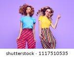 girl jumping having fun. young... | Shutterstock . vector #1117510535