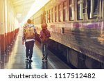 male and female backpackers... | Shutterstock . vector #1117512482