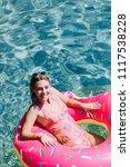 pretty woman lying on floating... | Shutterstock . vector #1117538228
