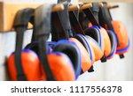 row of orange ear muffs ear... | Shutterstock . vector #1117556378