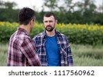 two farmers standing in oat...   Shutterstock . vector #1117560962