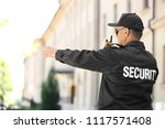 male security guard using... | Shutterstock . vector #1117571408