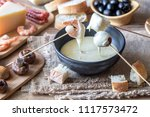 bowl of fondue with appetizers | Shutterstock . vector #1117573472