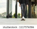 stylish male skateboarder... | Shutterstock . vector #1117576586