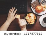 unhealthy snack at workplace.... | Shutterstock . vector #1117577912