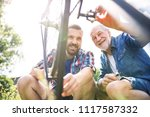 an adult hipster son and senior ... | Shutterstock . vector #1117587332