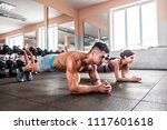 sporty couple doing plank... | Shutterstock . vector #1117601618
