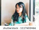 beautiful asian woman sitting... | Shutterstock . vector #1117603466