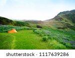 orange tent in icelandic... | Shutterstock . vector #1117639286