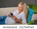 beautiful and happy blond woman ... | Shutterstock . vector #1117649162