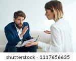 business man interviews a young ... | Shutterstock . vector #1117656635