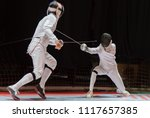 two man fencing athletes fight... | Shutterstock . vector #1117657385