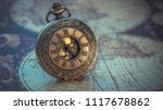 antique watch on old world map | Shutterstock . vector #1117678862