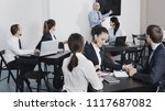 smiling efficient employeesin... | Shutterstock . vector #1117687082