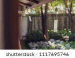 tiny alloy bell hanging from... | Shutterstock . vector #1117695746