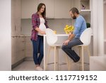 young pregnant couple cooking... | Shutterstock . vector #1117719152