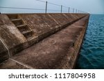 lighthouse breakwater quay two...   Shutterstock . vector #1117804958