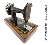 Antique Sewing Machine isolated on white with clipping path - stock photo
