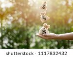 money bags fall into the hands... | Shutterstock . vector #1117832432