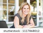 confident woman smiling.   Shutterstock . vector #1117868012