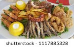 mixed seafood plate with fish... | Shutterstock . vector #1117885328