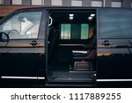Small photo of Open door of minivan. Luxury van open door