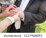 the moment of tying the wedding ... | Shutterstock . vector #1117968092