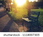 park  a chair in the park in... | Shutterstock . vector #1118007305
