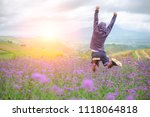 young man jumping on meadow... | Shutterstock . vector #1118064818