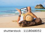 man reading travel blog on beach | Shutterstock . vector #1118068052
