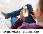 man using dating app on mobile... | Shutterstock . vector #1118068085