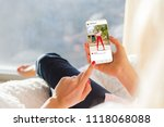 woman looking at photo sharing... | Shutterstock . vector #1118068088