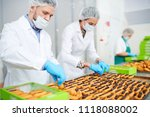 confectionery factory workers... | Shutterstock . vector #1118088002