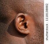 ear in a man with black skin | Shutterstock . vector #1118138882