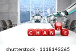 a white robot is sitting at a... | Shutterstock . vector #1118143265