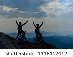 ride bicycles and reach high... | Shutterstock . vector #1118152412