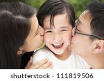 happy asian family in kissing | Shutterstock . vector #111819506