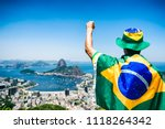 patriotic brazilian fan wrapped ...   Shutterstock . vector #1118264342